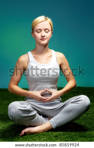 Portrait of a young meditating woman - stock photo