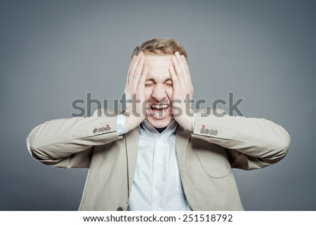 Portrait of a young men with facial expression.  - stock photo