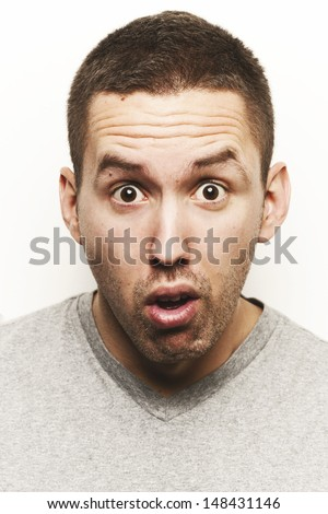 Portrait of a young men with facial expression. Studio shot. - stock photo