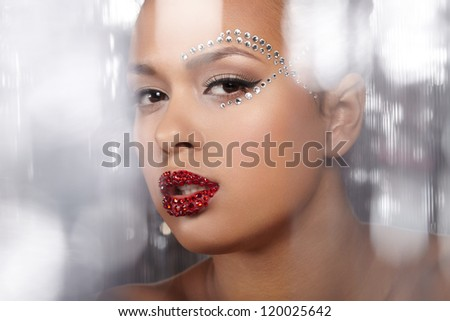 Portrait of a young model on shiny background - stock photo