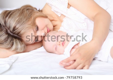 Portrait of a young mother and baby and a girl in her arms