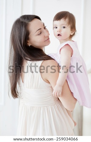 portrait of a young mother and her little daughter - stock photo