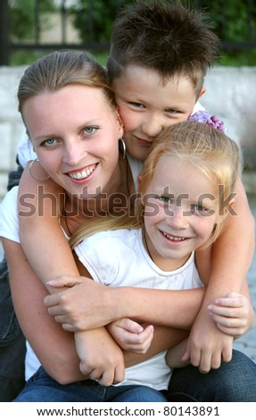 Portrait of a young mother with her daughter and son - stock photo