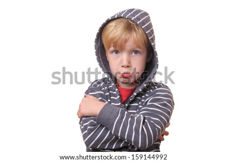 Portrait of a young offended boy on white Background - stock photo