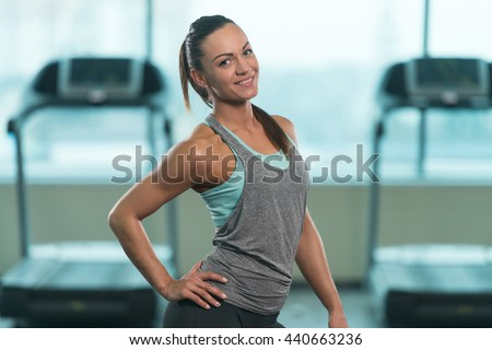 stock-photo-portrait-of-a-young-physically-fit-woman-showing-her-well-trained-body-muscular-athletic-440663236