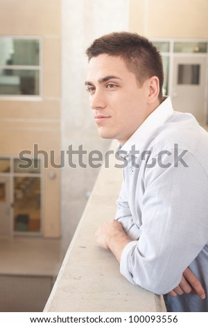 Portrait of a young professional man standing outside a building - stock photo