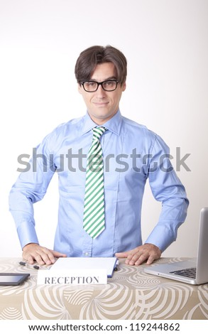 Portrait of a young receptionist working at the office and smiling. - stock photo