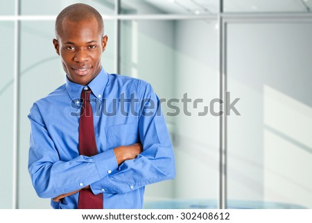 Portrait of a young smiling african businessman - stock photo
