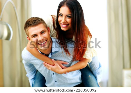 Portrait of a young smiling couple having fun - stock photo