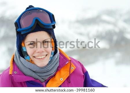 Portrait of a young, smiling female skier
