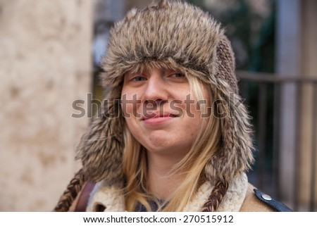 Portrait of a young smiling girl in a hat