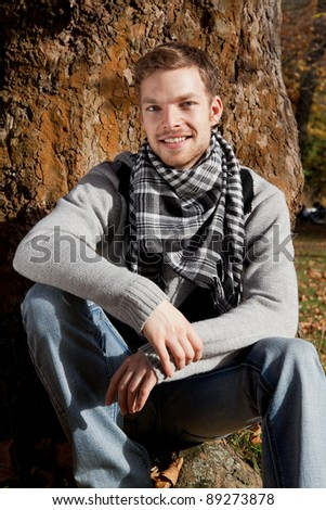 Portrait of a young smiling man outdoor - stock photo