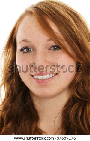portrait of a young smiling redhead woman on white background - stock photo