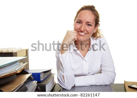 Portrait of a young smiling woman at desk in office - stock photo