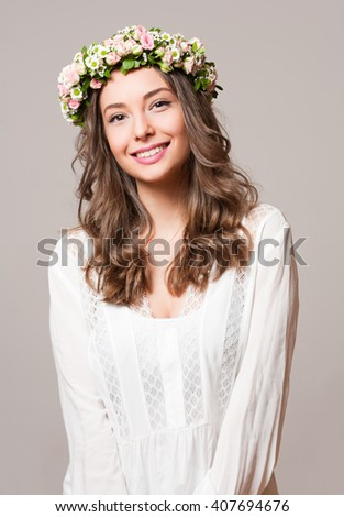Portrait of  a young spring beauty wearing flower wreath.