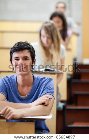 Portrait of a young student during examination in an amphitheater - stock photo