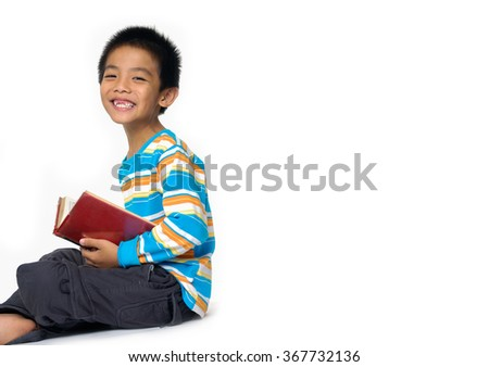 Portrait of a young student reading a book on the floor - stock photo