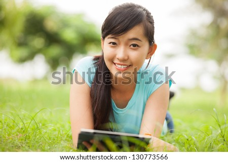 Portrait of a young student smiling and looking at camera - stock photo