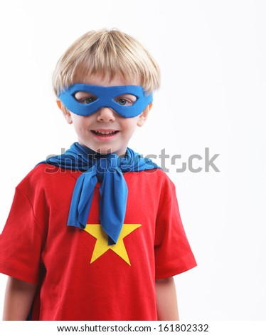 Portrait of a young superhero on white background - stock photo