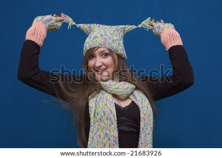 Portrait of a young surprised girl in winter hat - stock photo