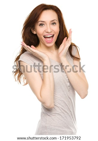 Portrait of a young surprised woman, isolated over white - stock photo
