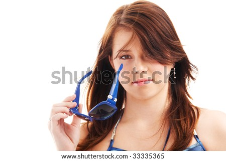 Portrait of a young teenage girl playing with sunglasses isolated on white background