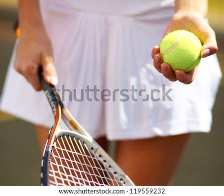 Portrait of a young tennis player standing ready for a serve
