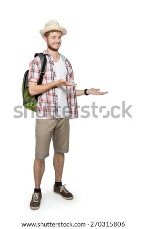 portrait of a young traveling man with backpack presenting to copyspace isolated on white background - stock photo