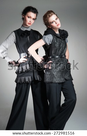 portrait of a young two fashion model in fashion dress in the studio - stock photo