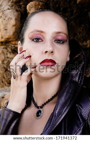 Portrait of a young vampire in the ruins Kunitzburg - stock photo