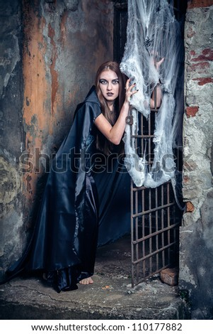 Portrait of a young witch. Halloween, horror. - stock photo