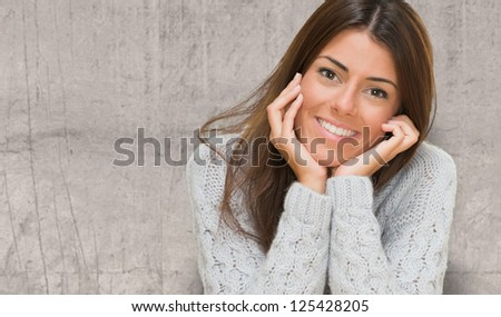 Portrait Of A Young Woman against a concrete wall