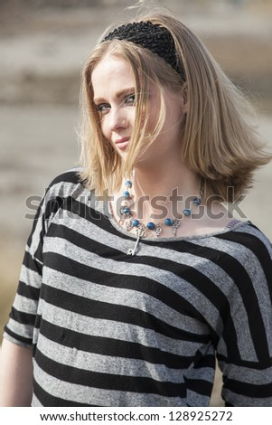 Portrait of a young woman at the beach. - stock photo