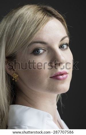 Portrait of a young woman, blank expression - stock photo