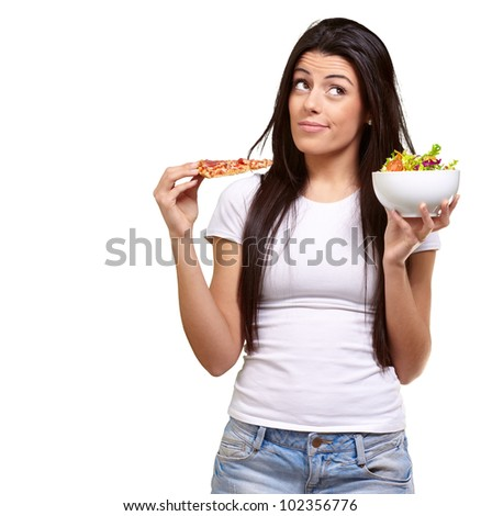portrait of a young woman choosing a pizza or a salad against a white background - stock photo