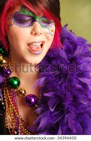 Portrait of a young woman dressed up for Mardi Gras