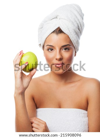 portrait of a young woman eating an apple after taking a bath - stock photo