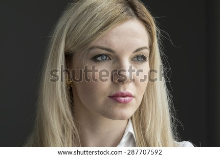 Portrait of a young woman, expressionless