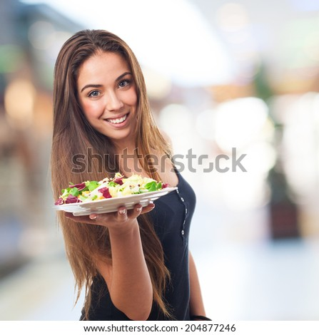 portrait of a young woman holding a delicious salad