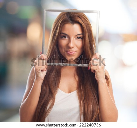 portrait of a young woman holding a frame
