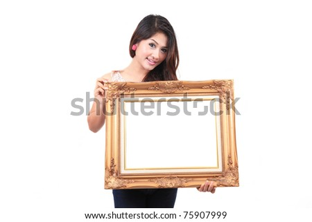 Portrait of a young woman holding a frame - stock photo