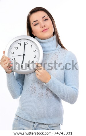 Portrait of a young woman holding big clock over white