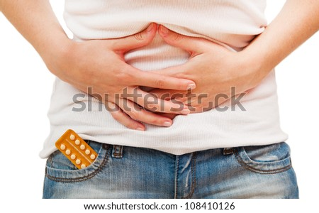 Portrait of a young woman holding birth control pills - stock photo