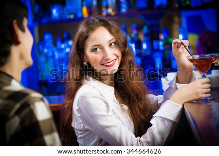 portrait of a young woman in a bar - stock photo