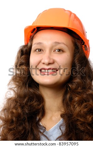 Portrait of a young woman in a hard hat isolated on white background. Construction worker or intern concept. - stock photo