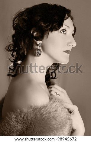 portrait of a young woman in vintage fashion style in hat - stock photo