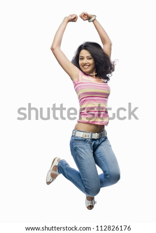Portrait of a young woman jumping - stock photo