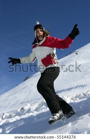 Portrait of a young woman  jumping in the snow
