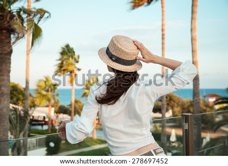 Portrait of a young woman looking on the sea - stock photo