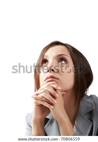 Portrait of a young woman looking up - stock photo